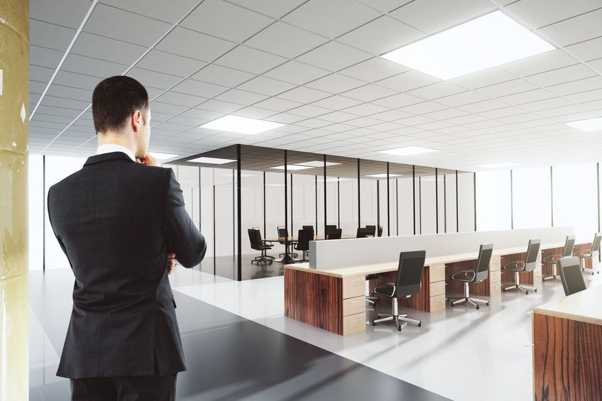 Business man staring into an empty office