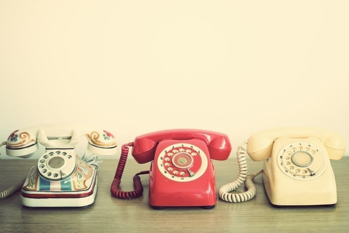 Telephones. Rotary dial phones. Communication.