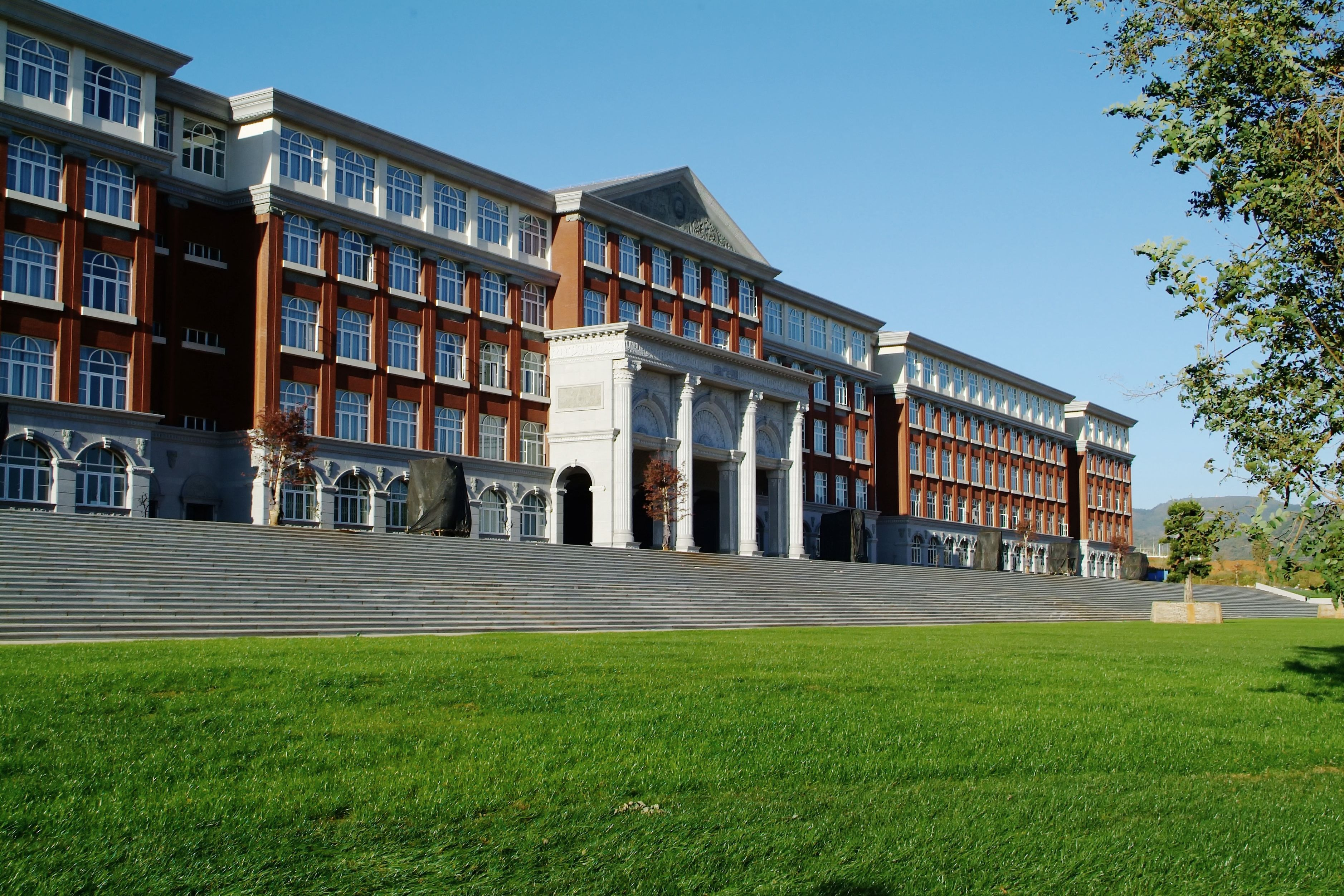 University building with a green lawn