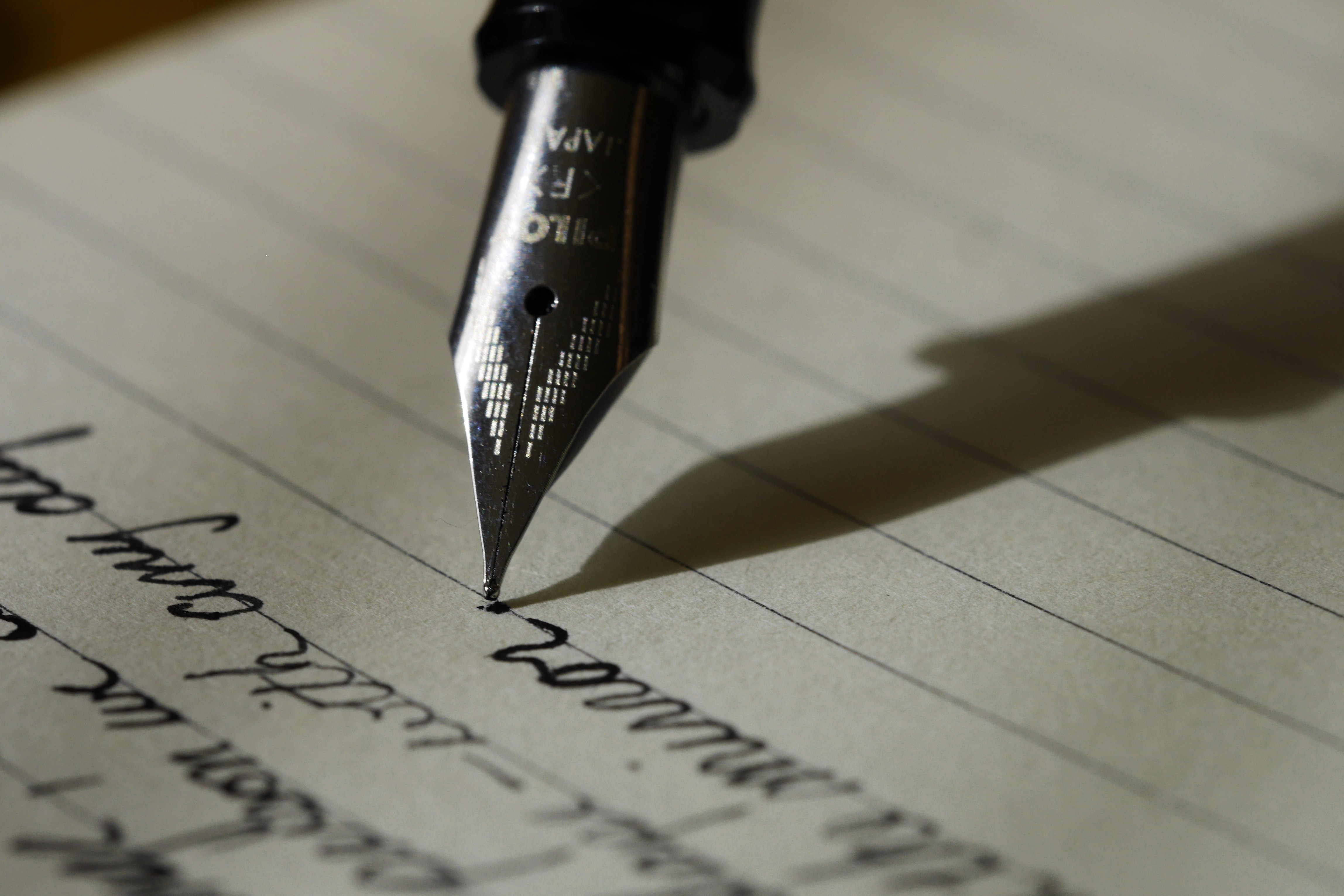 pen writing on lined paper